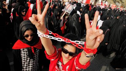 Rulla Jaffar, a doctor who is on trial for taking part in anti-government protest, wears chains on her hands as she participates in an anti-government rally in Budaiya, west of Manama, March 9, 2012 (Reuters / Hamad I Mohammed)