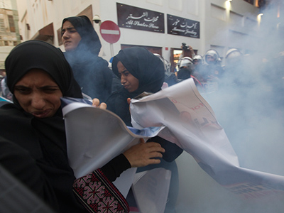 Protesters react after police used a flashbang sound grenade during an anti-government rally demanding the release of human rights activist Abdulhadi al-Khawaja in Manama April 18, 2012 (Reuters/Darren Whiteside)