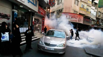 Press photographers take pictures as protesters run for cover from tear-gas fired by riot police during an anti-government march in downtown Manama September 7, 2012 (Reuters / Hamad I Mohammed)