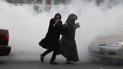 Demonstrators run through a cloud of tear gas fired by police during a protest in the village of Diraz, west of Manama April 21, 2012. (Reuters / Hamad I Mohammed)