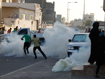 Anti-government protesters run to take cover from tear gas fired by riot police trying to disperse the march held in support of al-Quds day in a village on Sitra, south of Manama, August 17, 2012 (Reuters / Hamad I Mohammed)