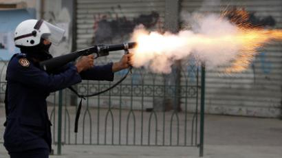 A riot police officer fires teargas during clashes with anti-government protesters after a rally held in support of opposition members currently serving life in prison, in the village of Bilad al-Qadeem, west of Manama, Bahrain, April 1, 2012. (Reuters / Hamad Mohammed)