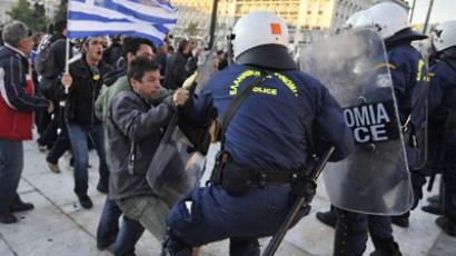 Riot policemen clashing with demonstraters at a protest in Athens on October 19, 2011, during a two-day general strike against new austerity measures and ahead of a vote on a bill demanded by Greece's international creditors to avert bankruptcy (AFP Photo / Louisa Gouliamaki)