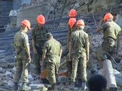 Baku building collapse: rescuers hear voices under rubble