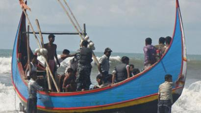 Rohingya refugees, who survived after their overloaded boat heading to Malaysia sank, are pictured on a fishing boat following their rescue by Bangladeshi border guards in Teknaf.(AFP Photo / STR)
