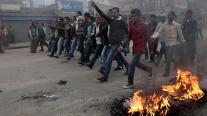 Activists of the Bangladesh Nationalist Party (BNP) shout slogans as they set fire to tyres during a nationwide blockade in Dhaka December 9, 2012.(Reuters / Andrew Biraj)