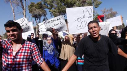 Protesters from Bani Walid shout slogans during a demonstration against the decision of the National Congress besieging the city of Bani Walid, in front of the National Congress in Tripoli.(Reuters / Ismail Zetouni)