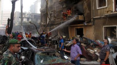 Lebanese security forces and rescue workers gather at the site of an explosion in Beirut's Christian neighbourhood of Ashrafieh on October 19, 2012. (AFP Photo/Patrick Baz)
