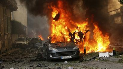 A car burns at the site of an explosion in Ashrafieh, east Beirut, October 19, 2012. (Reuters)