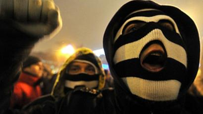 Belarus, Minsk: A protester wearing a mask shouts slogans during a protest march in the central of Minsk on December 19, 2010. (AFP Photo / Sergei Supinsky)