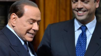 Former Italian Prime Minister Silvio Berlusconi (L) taking place for a press conference with the secretary general of the Popolo della Liberta (PDL) party, Angelino Alfano (AFP Photo / Filippe Monteforte)