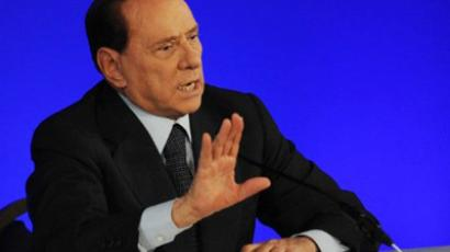 Italian Prime Minister Silvio Berlusconi talks during a press conference. (AFP Photo / Pascal Guyot)