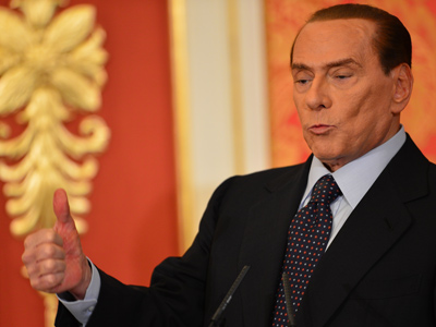 "Italy's former Prime Minister Silvio Berlusconi speaks during a press conference on October 27, 2012 at his residence, villa Gernetto in Lesmo, near Monza. Berlusconi said the same day he felt ""obliged"" to stay in politics to reform the justice system, the day after he was found guilty of tax fraud and sentenced to a year in prison (AFP Photo)"