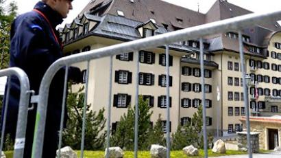 A private policeman guarding the Suvretta House five-star hotel on June 9, 2011 (AFP Photo / Fabrice Coffrini)