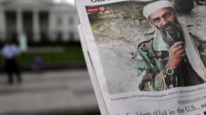 Front page of a newspaper featuring a picture of Al-Qaeda leader Osama Bin Laden, in front of the White House in Washington, DC (AFP Photo / Jewel Samad)