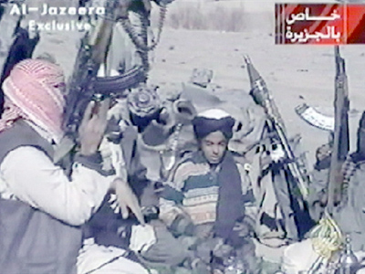 Hamza Bin Laden surrounded by armed militia as he recites a poem (AFP Photo / AL-JAZEERA)