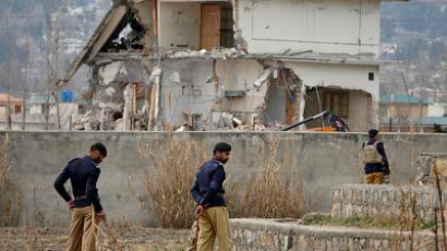 Policemen stand guard near the partially demolished compound where al-Qaeda leader Osama bin Laden was killed by US special forces last May, in Abbottabad February 26, 2012 (Reuters/Faisal Mahmood)
