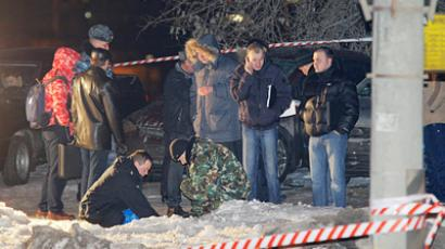 Police examining the site of explosion near the Federal Security Service academy on March 9, 2011 (RIA Novosti / STF)