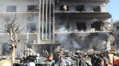 People gathering at the scene following a two bomb attacks on security buildings in the heart of the Syrian capital Damascus on March 17, 2012 (AFP Photo / HO)