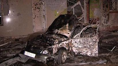 Makhachkala: A video grab released by News Team agency shows a damaged car at the site of the twin explosions in Makhachkala, the capital of Russia's North Caucasus region of Dagestan, early on September 22, 2011. (AFP Photo / News Team)