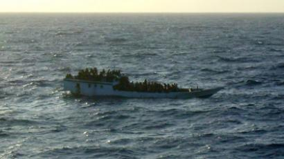 A picture released by the Australian Maritime and Safety Authority (AMSA) shows a boat which according to the AMSA was taken mid-morning before the boat sank near Christmas Island June 27, 2012 (Reuters/Australian Maritime and Safety Authority/Handout)