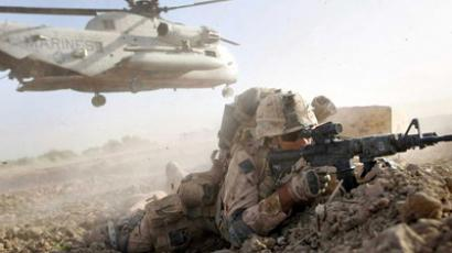 Marine takes up a fighting position after off loading from a helicopter (AFP Photo / Getty Images)