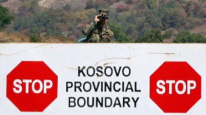 Serbia, Jarinje: A German KFOR soldier stands guard at the Jarinje border crossing between Serbia and Kosovo. (AFP Photo / Sasa Djordjevic)