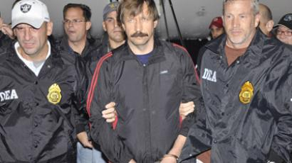 Suspected Russian arms dealer Viktor Bout (front C) is escorted by Drug Enforcement Administration (DEA) officers after arriving at Westchester County Airport in White Plains, New York, in this November 16, 2010. (Reuters / U.S. Department of Justice/Handout / Files)