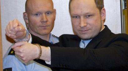 Anders Behring Breivik (R), 32, arrives on February 6, 2012 in court in Oslo  (AFP Photo / Daniel Sannum Lauten)