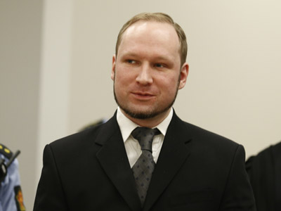 Mass murderer Anders Behring Breivik arrives at the court room in Oslo Courthouse on August 24, 2012. (AFP Photo/Heiko Junge)