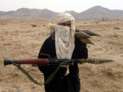A Taliban fighter poses with weapons in an undisclosed location in Afghanistan.(Reuters / Stringer Afghanistan)