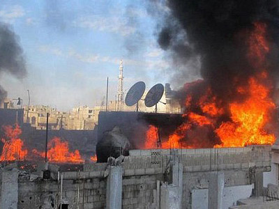 Fire on the roof of a building in the Baba Amr neighborhoud of the flashpoint city of Homs, allegedly during the bombardment of the city (AFP Photo)