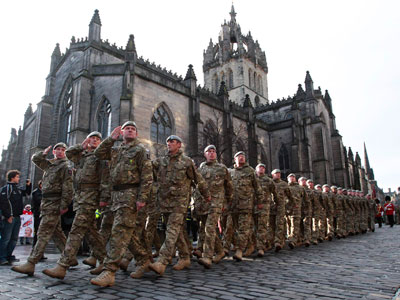 Soldiers of the British Army's Royal Scots Dragoon Guards regiment march past St. Giles Cathedral in the Royal Mile to mark their return from a tour of duty in Helmand Province in Afghanistan during a Homecoming parade in Edinburgh, Scotland.(Reuters / David Moir)