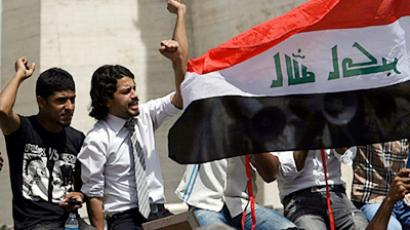 People shout slogans and wave a flag of Iraq during the weekly friday demonstration to denounce corruption, unemployment and poor public services in Baghdad's Tahrir Square on April 15, 2011 (AFP Photo / Ali Al Saadi)