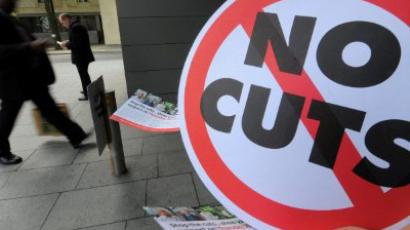 Manchester : A man walks past a sign held by striking public sector workers outside the Civil Justice centre in Manchester, north-west England, on June 30, 2011. (AFP Photo/ Andrew Yates)