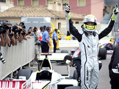 Jenson Button celebrates in the parc ferme of the Monaco racetrack (AFP Photo / Fred Dufour)
