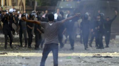 A protester shouts slogans during clashes with riot police along a road which leads to the U.S. embassy, near Tahrir Square in Cairo September 13, 2012. (Reuters/Amr Abdallah Dalsh)