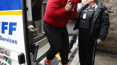 Jeffrey Paul Delisle jumps out of a Sheriff van after arriving at the provincial court in Halifax (Reuters / Paul Darrow)