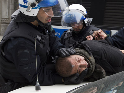 A protestor is arrested by police after a student demonstration against tuition hikes in Montreal, Quebec, April 20, 2012. (Reuters / Christinne Muschi)