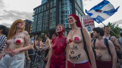 Naked students protest againt the Liberal Governament, Special Law 78, and tuition fee increases on June 7, 2012 in Montreal, Canada. (AFP Photo/Rogerio Barbosa)