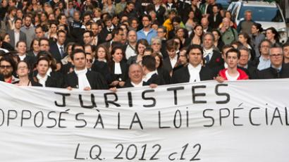 "Lawyers and notaries gather for a ""silent"" march to protest against Bill 78, in the streets of Montreal May 28, 2012 (Reuters/Olivier Jean)"