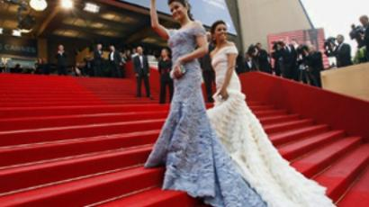 Aishwarya Rai and Eva Longoria at the opening ceremony of the 63rd Cannes Film Festival. (AFP Photo / Valery Hache)