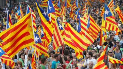 Marchers wave Catalonian nationalist flags as they demonstrate during Catalan National Day in Barcelona (Reuters/Albert Gea)