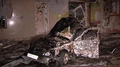 A video grab released by News Team agency shows a damaged car at the site of the twin explosions in Makhachkala, the capital of Russia's North Caucasus region of Dagestan, early on September 22, 2011. (AFP PHOTO / NEWS TEAM)