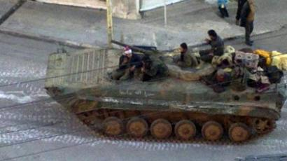 A Syrian army tank is seen in the neighbourhood of Zabadani, near Damascus (Reuters / Handout)