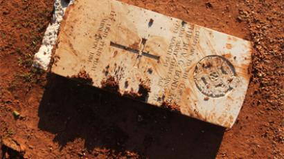 Gravestone is seen damaged by an Islamist group in protest at burning of Koran by US soldiers in Afghanistan in Benghazi Military Cemetery (Reuters / Esam Al-Fetori) (Video from YouTube, uploaded by user CanoPinto 29 Feb 2012 )