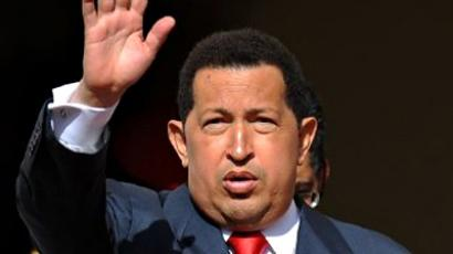 Venezuela, Caracas : Venezuelan President Hugo Chavez waves during the welcoming ceremony of Peruvian President elect Ollanta Humala (not depicted) at the Miraflores presidential palace in Caracas on July 15, 2011. (AFP Photo / Juan Barreto)