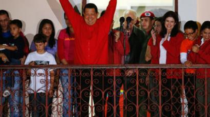 Venezuelan president Hugo Chavez celebrates from people's balcony at Miraflores Palace in Caracas.(Reuters / Jorge Silva)