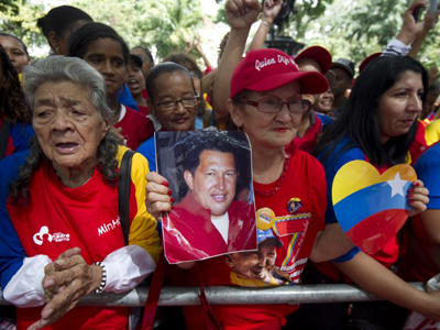 Supporters of Venezuela's President Hugo Chavez rally in Caracas. (AFP Photo / Juan Barreto)