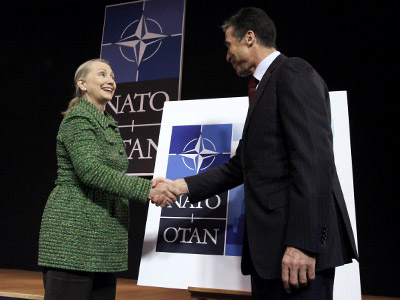 U.S. Secretary of State Hillary Clinton (L) and NATO Secretary General Anders Fogh Rasmussen shake hands after unveiling the logo of the Chicago summit meeting (Reuters / Sebastien Pirlet)
